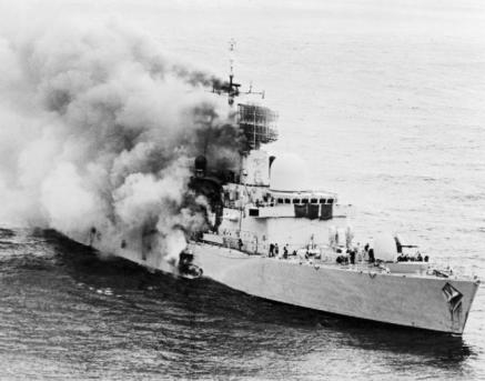 HMS Sheffield on fire after being hit by a missile