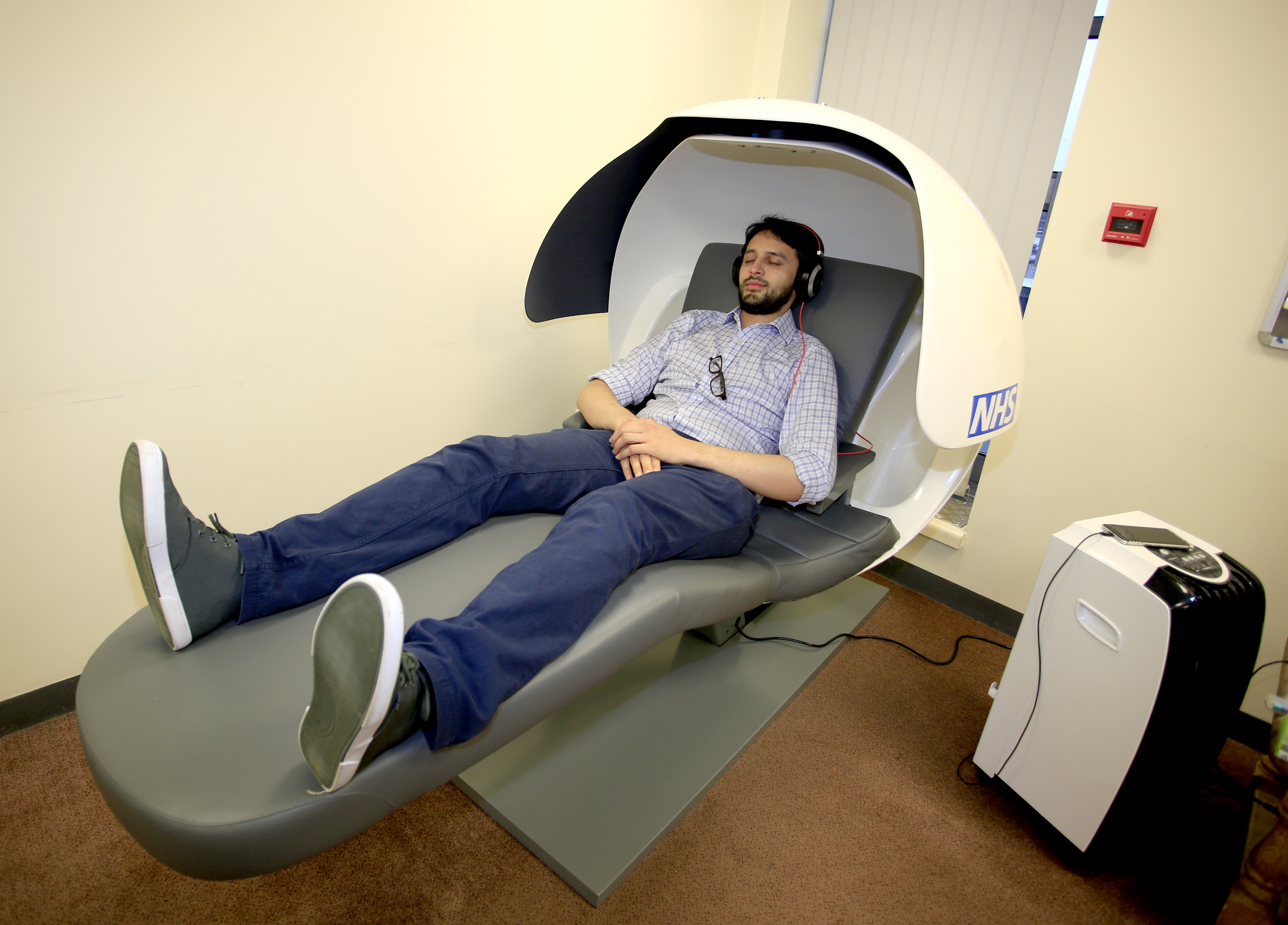 Syed Husain, junior doctor at Wye Valley NHS Trust trying out the sleep pod at Hereford County Hospital.